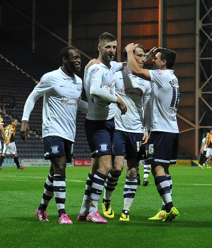 The PNE players celebrate their third goal scored by Preston North End's Paul Gallagher<br /> <br /> Photographer Dave Howarth/CameraSport<br /> <br /> Football - Johnstone's Paint Trophy Northern Area Second Round - Preston North End v Port Vale - Tuesday 07th October 2014 - Deepdale - Preston<br />  <br /> &copy; CameraSport - 43 Linden Ave. Countesthorpe. Leicester. England. LE8 5PG - Tel: +44 (0) 116 277 4147 - admin@camerasport.com - www.camerasport.com