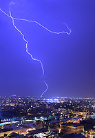 Aug. 21, 2012; Phoenix, AZ, USA: lightning bolt storm monsoon rain city Phoenix strike thunderstorm lights Mandatory Credit: Mark J. Rebilas