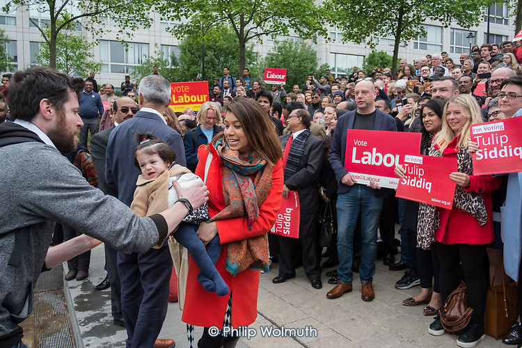 Tulip Siddiq with her daughter Azalea at the launch of her campaign to retain Hampstead and Kilburn, the tenth most marginal Labour parliamentary seat in the UK.  Swiss Cottage, London.