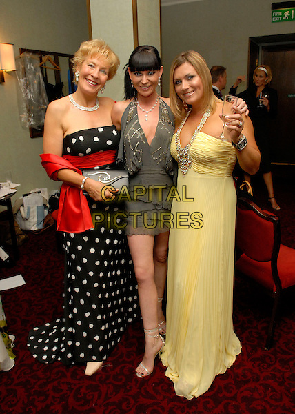 CHRISTINE HAMILTON, LUCY PARGETER & TRICIA PENROSE.At the Miss Great Britain 2007 Grand Final,.Grosvenor House Hotel, Park Lane, London, England, .May 21st 2007..full length black and white polka dot strapless dress yellow red grey mini Trisha.CAP/FIN.©Steve Finn/Capital Pictures.
