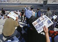 02 NOV 2003 - ATHENS, GREECE - Spectators watch finishers of the 21st Athens Classic Marathon in the Kallimarmaro Stadium. (PHOTO (C) NIGEL FARROW)