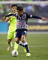 Mike Fucito, right, of CF Monterrey dribbles the ball in front of Fredy Montero of the Seattle Sounders FC during a CONCACAF Champions League match at CenturyLink Field in Seattle Tuesday Oct. 18, 2011. CF Monterrey won the game 2-1.