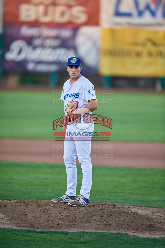 Reza Aleaziz (43) of the Ogden Raptors looks in for the sign during a game against the Grand Junction Rockies at Lindquist Field on September 7, 2018 in Ogden, Utah. The Rockies defeated the Raptors 8-5. (Stephen Smith/Four Seam Images)