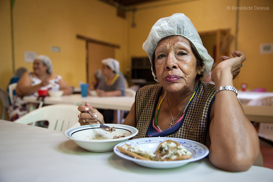 Luchita, a resident of Casa Xochiquetzal, during lunch time at the shelter in Mexico City, Mexico on August 16, 2013. Casa Xochiquetzal is a shelter for elderly sex workers in Mexico City. It gives the women refuge, food, health services, a space to learn about their human rights and courses to help them rediscover their self-confidence and deal with traumatic aspects of their lives. Casa Xochiquetzal provides a space to age with dignity for a group of vulnerable women who are often invisible to society at large. It is the only such shelter existing in Latin America. Photo by Bénédicte Desrus