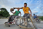 Alejandro Jarquin tries to pass the basketball while Roel Hernandez attempts a block during practice in Zipolite, a town in Oaxaca, Mexico. Jarquin and Hernandez are part of the Oaxaca Costa wheelchair basketball team.