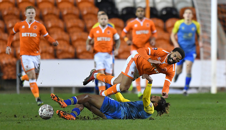 Blackpool's Liam Feeney is fouled by  Solihull Moors' Jamie Reckord<br /> <br /> Photographer Dave Howarth/CameraSport<br /> <br /> The Emirates FA Cup Second Round Replay - Blackpool v Solihull Moors - Tuesday 18th December 2018 - Bloomfield Road - Blackpool<br />  <br /> World Copyright © 2018 CameraSport. All rights reserved. 43 Linden Ave. Countesthorpe. Leicester. England. LE8 5PG - Tel: +44 (0) 116 277 4147 - admin@camerasport.com - www.camerasport.com