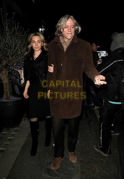 JEANNE MARINE & SIR BOB GELDOF.George Clooney gala dinner, L'Atelier de Joel Robuchon restaurant, London, England..April 7th, 2008.full length black jacket brown coat boots couple scarf.CAP/CAN.©Can Nguyen/Capital Pictures.