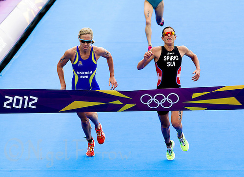 04 AUG 2012 - LONDON, GBR - Lisa Norden (SWE) of Sweden (left) and Nicola Spirig (SUI) of Switzerland (right) sprint for the line at the end of the women's London 2012 Olympic Games Triathlon in Hyde Park in London, Great Britain (PHOTO (C) 2012 NIGEL FARROW)