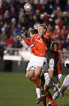 Clemson's David Gualdarama (in orange) and New Mexico's Jeff Rowland (behind) challenge for a header. The University of New Mexico Lobos defeated the Clemson University Tigers 2-1 in a Men's College Cup Semifinal at SAS Stadium in Cary, NC, Friday, December 9, 2005.