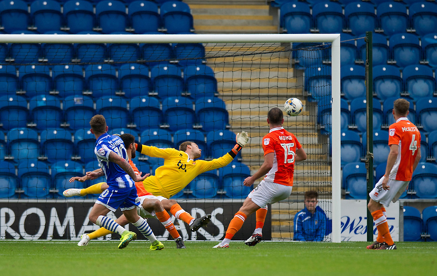 Colchester United's Sammie Szmodicse scores his sides equalising goal to make the score 1-1 despite the efforts of Blackpool's Sam Slocombe<br /> <br /> Photographer Ashley Western/CameraSport<br /> <br /> The EFL Sky Bet League Two - Colchester United v Blackpool - Saturday 10th September 2016 - Colchester Community Stadium - Colchester<br /> <br /> World Copyright &copy; 2016 CameraSport. All rights reserved. 43 Linden Ave. Countesthorpe. Leicester. England. LE8 5PG - Tel: +44 (0) 116 277 4147 - admin@camerasport.com - www.camerasport.com
