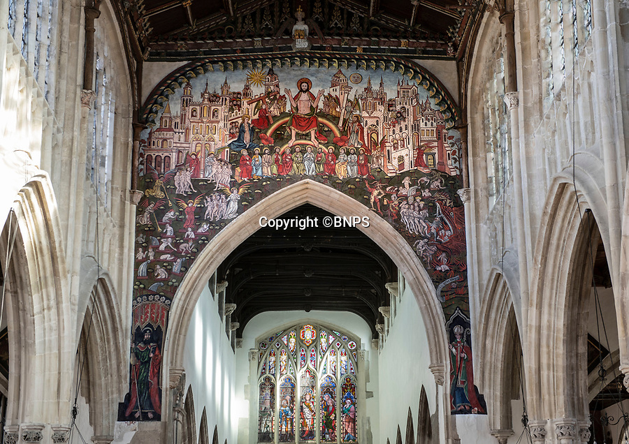 BNPS.co.uk (01202 558833)<br /> Pic: PhilYeomans/BNPS<br /> <br /> Doom finally has its day! - A 500 year old 'Day of Judgement' painting that has survived Henry VIII th, the Puritans and even Victorian prudery has been restored to its former glory.<br /> <br /> Thought to be the largest medieval 'Doom' painting in the country, the striking image been painstakingly restored after a tumultuous 500 year history on the chancel arch of St Thomas Becket church in Salisbury.<br /> <br /> Most pre 16th century churches and cathedrals in Britain would have been plastered with religious images and iconography to encourage their often illiterate congregation to good behaviour.<br /> <br /> But during Henry VIII th Protestant Reformation churches were stripped of all graven imagery and the paintings were either whitewashed over or completely destroyed.<br /> <br /> Originally painted in the 15th century, the chancel was white-washed during the Reformation before being uncovered nearly 300 years later in the early 19th century. <br /> <br /> Prudish Victorian's shocked by the naked images then recovered it before it finally re-emerged in 1881 as opinions relaxed. <br /> <br /> Experts have spent three months conserving the faded painting, which involved injecting lime slurry behind areas of paint to affix them again to the wall. They 'touched up' the painting in places before finishing it with varnish to bring out its colour.<br /> <br /> The restoration is part of a larger set of works at the church which are due to cost £1.5million.