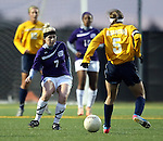 SIOUX FALLS, SD - NOVEMBER 1:  Caitlin Crouse #7 from the University of Sioux Falls defends against Kara Bartels #5 from Augustana in the first half of their game Friday night at the USF Sports Complex. (Photo by Dave Eggen/Inertia)
