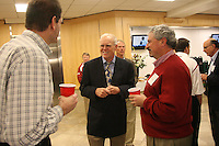 STANFORD, CA - FEBRUARY 4:  President John Hennessy talks with Earl Koberlein and Joe Mitchner during the 2009 Signing Day Reception on February 4, 2009 at Stanford Stadium in Stanford, California.