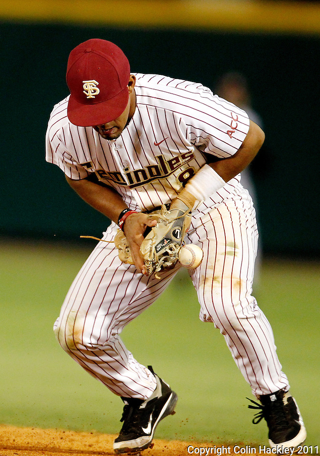 TALLAHASSEE, FL 5/7/11-FSU-UCFBASE11 CH-Florida State's Devon Travis struggles with a grounder hit by the  University of Central Florida Saturday at Dick Howser Stadium in Tallahassee. The ball got by Travis and he earned an error on the eighth inning play. The Seminoles lost to the Knights 10-14..COLIN HACKLEY PHOTO