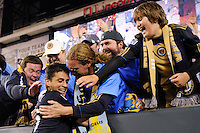 Cristian Arrieta (26) of the Philadelphia Union celebrates with fans after the game. The Philadelphia Union defeated D. C. United 3-2 during a Major League Soccer (MLS) match at Lincoln Financial Field in Philadelphia, PA, on April 10, 2010.