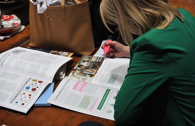 A member of the media looks at documents in the Budget Lockup at Parliament House in Canberra, Australia, on Tuesday, May 9, 2017.  Photographer: Mark Graham/Bloomberg