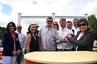 Connections of Initiative receive their trophy after winning  The Bathwick Tyres Novice Auction Stakes(plus 10, Div 1), during Afternoon Racing at Salisbury Racecourse on 13th June 2017