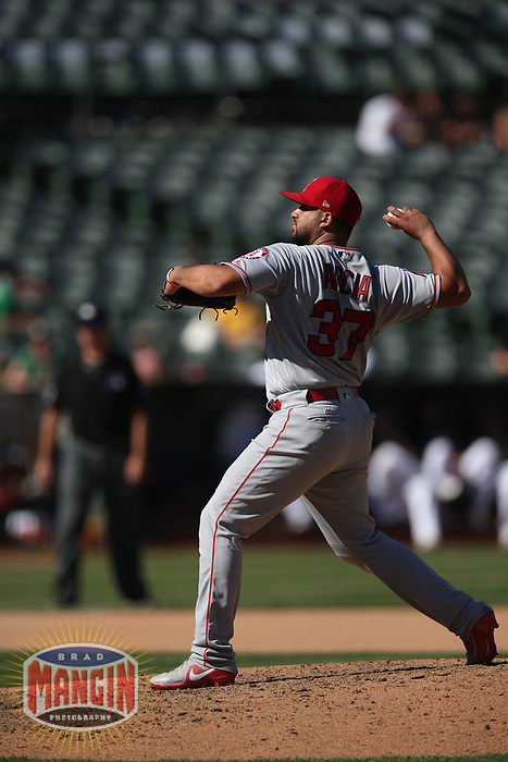 OAKLAND, CA - SEPTEMBER 20:  Francisco Arcia #37 of the Los Angeles Angels of Anaheim pitches against the Oakland Athletics during the game at the Oakland Coliseum on Thursday, September 20, 2018 in Oakland, California. (Photo by Brad Mangin)