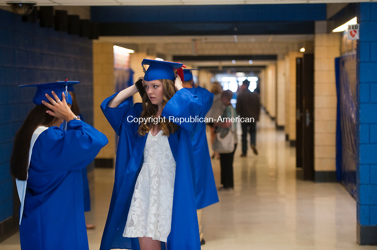 WOODBURY,  CT-061717JS11- Graduates Grace Hanley, left, and Sofia Eschmann, right, adjust their caps as they prepare for graduation ceremonies Saturday at Nonnewaug High School in Woodbury. <br /> Jim Shannon Republican-American