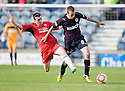 Raith's David Smith challenges Partick's Stuart Bannigan ...