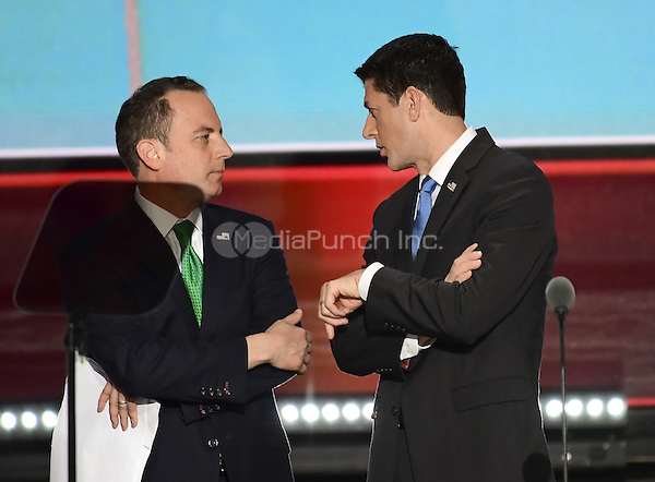 Reince Priebus, RNC Chairman, left, and Speaker of the United States House of Representatives Paul Ryan (Republican of Wisconsin), right, have a conversation on the podium at the 2016 Republican National Convention held at the Quicken Loans Arena in Cleveland, Ohio on Tuesday, July 19, 2016.<br /> Credit: Ron Sachs / CNP/MediaPunch<br /> (RESTRICTION: NO New York or New Jersey Newspapers or newspapers within a 75 mile radius of New York City)
