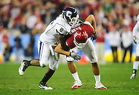 Jan. 1, 2011; Glendale, AZ, USA; Connecticut Huskies linebacker (8) Lawrence Wilson tackles Oklahoma Sooners tight end (82) James Hanna in the 2011 Fiesta Bowl at University of Phoenix Stadium. The Sooners defeated the Huskies 48-20. Mandatory Credit: Mark J. Rebilas-