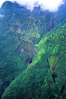 Several long waterfalls pour down the lush inaccessible mountains on the Kohala area of the Big Island of Hawaii.