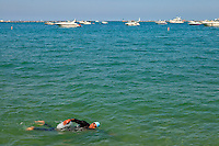 Boaters and a lone swimmer take in an enjoyable summer day on Lake Michigan near downtown Chicago, Ill.