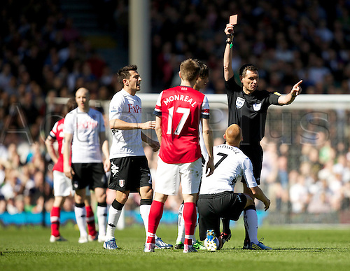 20.04.2013 London, England.  The referee shows a red card to Steve Sidwell after this challenge on Mikel Arteta of Arsenal during the Premier League game between Fulham and Arsenal from Craven Cottage.