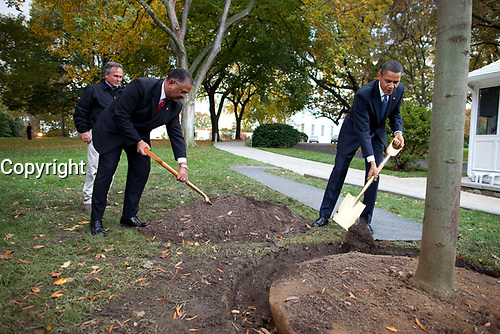 President Barack Obama, along with Grounds Superintendent Dale Haney and Chief Usher Rear Admiral Stephen W. Rochon (Ret.), participates in a commemorative tree planting ceremony on the North Grounds of the White House, Oct 28, 2009.  (Official White House Photo by Chuck Kennedy)<br /> <br /> This official White House photograph is being made available only for publication by news organizations and/or for personal use printing by the subject(s) of the photograph. The photograph may not be manipulated in any way and may not be used in commercial or political materials, advertisements, emails, products, promotions that in any way suggests approval or endorsement of the President, the First Family, or the White House.