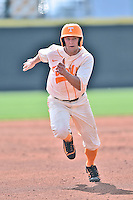 Tennessee Volunteers third baseman Nick Senzel (13) runs to third during game one of a double header against the UC Irvine Anteaters at Lindsey Nelson Stadium on March 12, 2016 in Knoxville, Tennessee. The Volunteers defeated the Anteaters 14-4. (Tony Farlow/Four Seam Images)