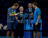 Hideo Takasaki CEO and COO of Sponsors Nitto, present the doubles trophy to the winners Henri Kontinen/John Peers. Mark Kermode Executive Chairman and President ATP in the background.  Nitto ATP Finals Tennis Championships, O2 Arena London, England,19th November 2017.