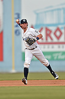 Asheville Tourists shortstop Brendan Rodgers (1) fields the ball and throws to first base during a game against the Columbia Fireflies at McCormick Field on August 17, 2016 in Asheville, North Carolina. The Tourists defeated the Fireflies 7-6. (Tony Farlow/Four Seam Images)