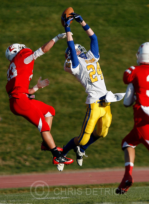 Chris Detrick  |  The Salt Lake Tribune.Orem's Nolan Gray (24) can't make a catch while being defended by East's Zach Swenson (23) and East's Niel Robbins (3) during the game at East High School Friday October 28, 2011.  East won the game 31-13.