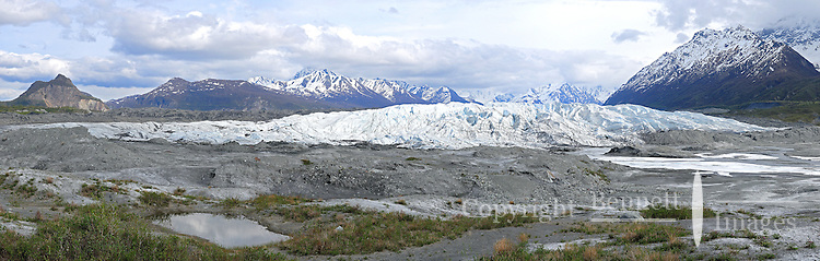 This view of the Matanuska Glacier in Southcentral Alaska includes the distinctive rock formation known as Lion Head at the far left. For scale, note there are people walking on the glacier in the center of the photo.