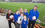Pupils rom Deighton Primary School in Tredegar Lowri Molloy, Tyrhys Lewis &amp; Dylan Hughes holding a certificate presented to Jenna Llewellyn from TATA Steel (back row) acknowledging the donation the company has made to the Regions community program along with Dragons hooker Sam Parry and community officer Mike Sage who presented teacher Sarah Lewis with match tickets.<br /> <br /> 02.10.13<br /> <br /> &copy;Steve Pope-FOTOWALES