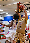WATERBURY, CT. 10 January 2020-011020BS510 - Sacred Heart's Connor Tierney (0), right, grabs a rebound away from Crosby's Jason Robinson (14), during a NVL cross city Boys Basketball game between Sacred Heart and Crosby at the Palace at Crosby High in Waterbury on Friday. Bill Shettle Republican-American