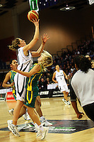 Tall Ferns forward Lisa Wallbutton collides with Jessica Biddy as she puts a shot up during the International women's basketball match between NZ Tall Ferns and Australian Opals at Te Rauparaha Stadium, Porirua, Wellington, New Zealand on Monday 31 August 2009. Photo: Dave Lintott / lintottphoto.co.nz