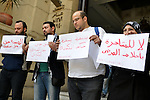 Egyptian employees of health sector hold banners during a protest against the claimed Hepatitis C cure invented by the Egyptian armed forces, in Cairo on February 3, 2015. Egyptian military had developed last year a cure for the virus that causes AIDS, as well as hepatitis C, one of Egypt's gravest public health threats and said that needs six more months of testing. Photo by Amr Sayed