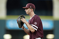 Mississippi State Bulldogs first baseman Josh Hatcher (10) on defense against the Louisiana Ragin' Cajuns in game three of the 2018 Shriners Hospitals for Children College Classic at Minute Maid Park on March 2, 2018 in Houston, Texas.  The Bulldogs defeated the Ragin' Cajuns 3-1.   (Brian Westerholt/Four Seam Images)