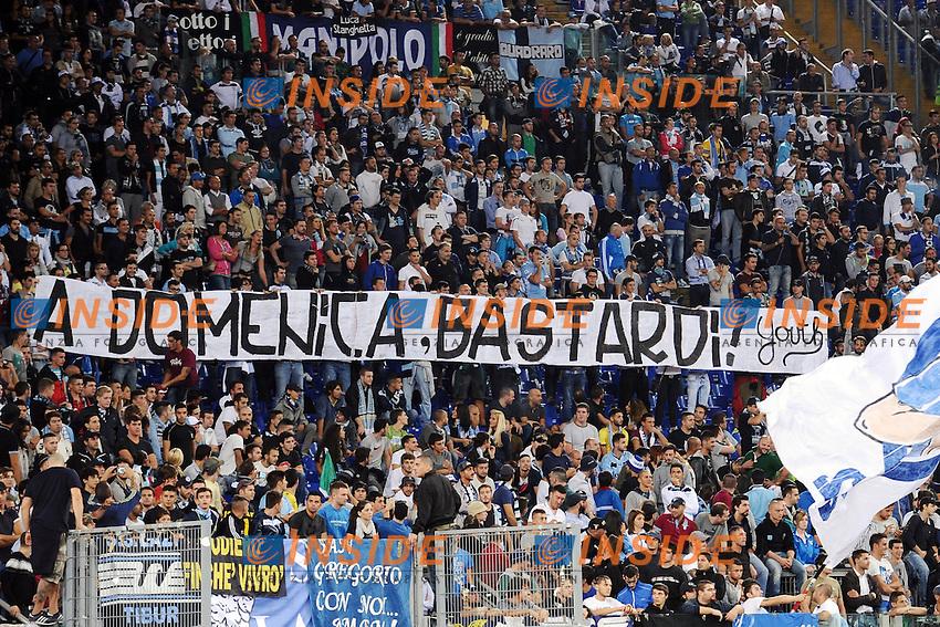 Striscione dei tifosi della Lazio per i romanisti<br /> Roma 19-09-2013 Stadio Olimpico<br /> Football Calcio 2013/2014 Europa League<br /> Lazio - Legia Varsavia / Lazio - Legia Warszawa 1-0<br /> Foto Antonietta Baldassarre Insidefoto