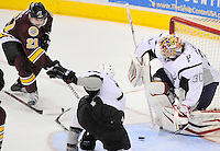 Chicago Wolves' Kevin Doell (21) shoots as San Antonio Rampage goaltender Jacob Markstrom (30) and Rampage defenseman Roman Derlyuk defend the net during the third period of an AHL playoff hockey game, Saturday, April 21, 2012, in San Antonio. San Antonio won 4-3. (Darren Abate/pressphotointl.com)