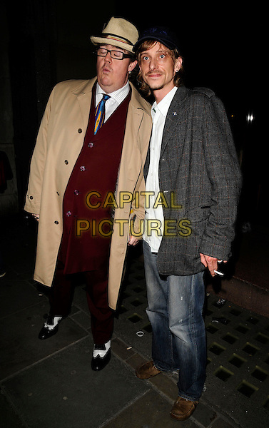 "PHIL JUPITUS & MAKENZIE CROOK.At the ""Fat Pig"" Press Night,.Trafalgar Studios, 1 Whitehall, London,.England, UK, May 27th 2008..full length hat beige coat red suit tie grey gray jeans cap black and white shoes glasses.CAP/CAN.©Can Nguyen/Capital Pictures"