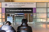 Inside the arrivals area of Logan Airport Terminal E in Boston, Massachusetts, USA. An Executive Order signed by President Donald Trump bans travel for many from seven Muslim-majority countries.