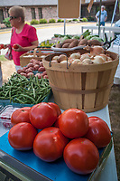 Fresh tomatoes for sale at a local farmers market.