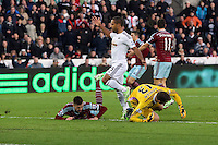 Pictured: Wayne Routledge of Swansea (C) has his shot stoped by Adrian (R) goalkeeper for West Ham Saturday 10 January 2015<br />