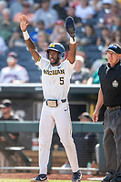 Michigan Wolverines outfielder Christian Bullock (5) celebrates at the plate after scoring during Game 11 of the NCAA College World Series against the Texas Tech Red Raiders on June 21, 2019 at TD Ameritrade Park in Omaha, Nebraska. Michigan defeated Texas Tech 15-3 and is headed to the CWS Finals. (Andrew Woolley/Four Seam Images)