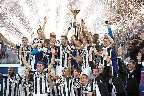 "11.05.2013 Turin, Italy. Juventus team group celebrate their league title (29th Scudetto) with the trophy after the Italian ""Serie A"" match between Juventus 1-1 Cagliari at Juventus Stadium."