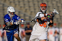 Brian Carroll (36) of Virginia passes the ball away from Sam Solie (23) of Duke during the ACC men's lacrosse tournament semifinals in College Park, MD.  Virginia defeated Duke, 16-12.