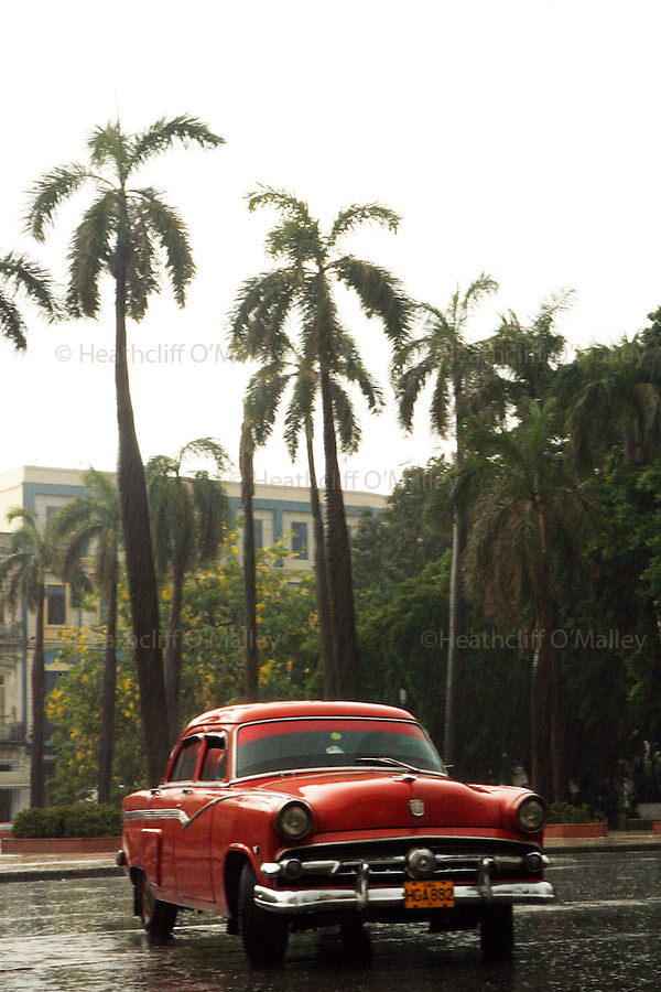 Street scene and Vintage American car ,Havana,Cuba. Due to ownership restrictions and U.S embargoes thousands of vintage pre 1960's cars can be found across Cuba in various states of repair.
